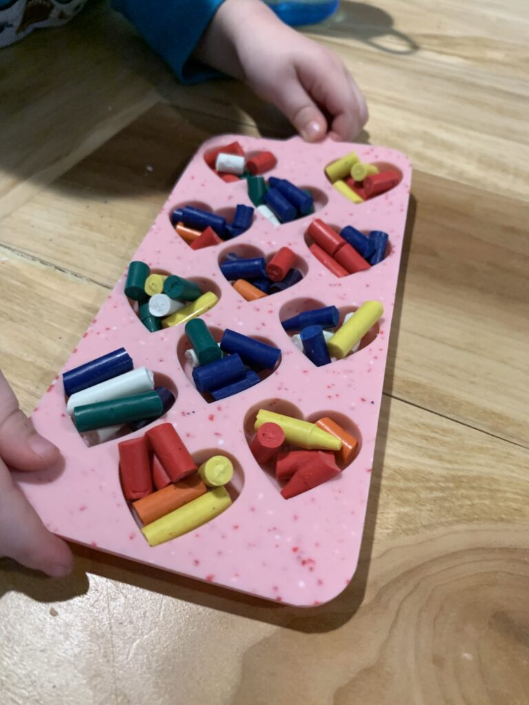heart shaped mold filled with broken crayons