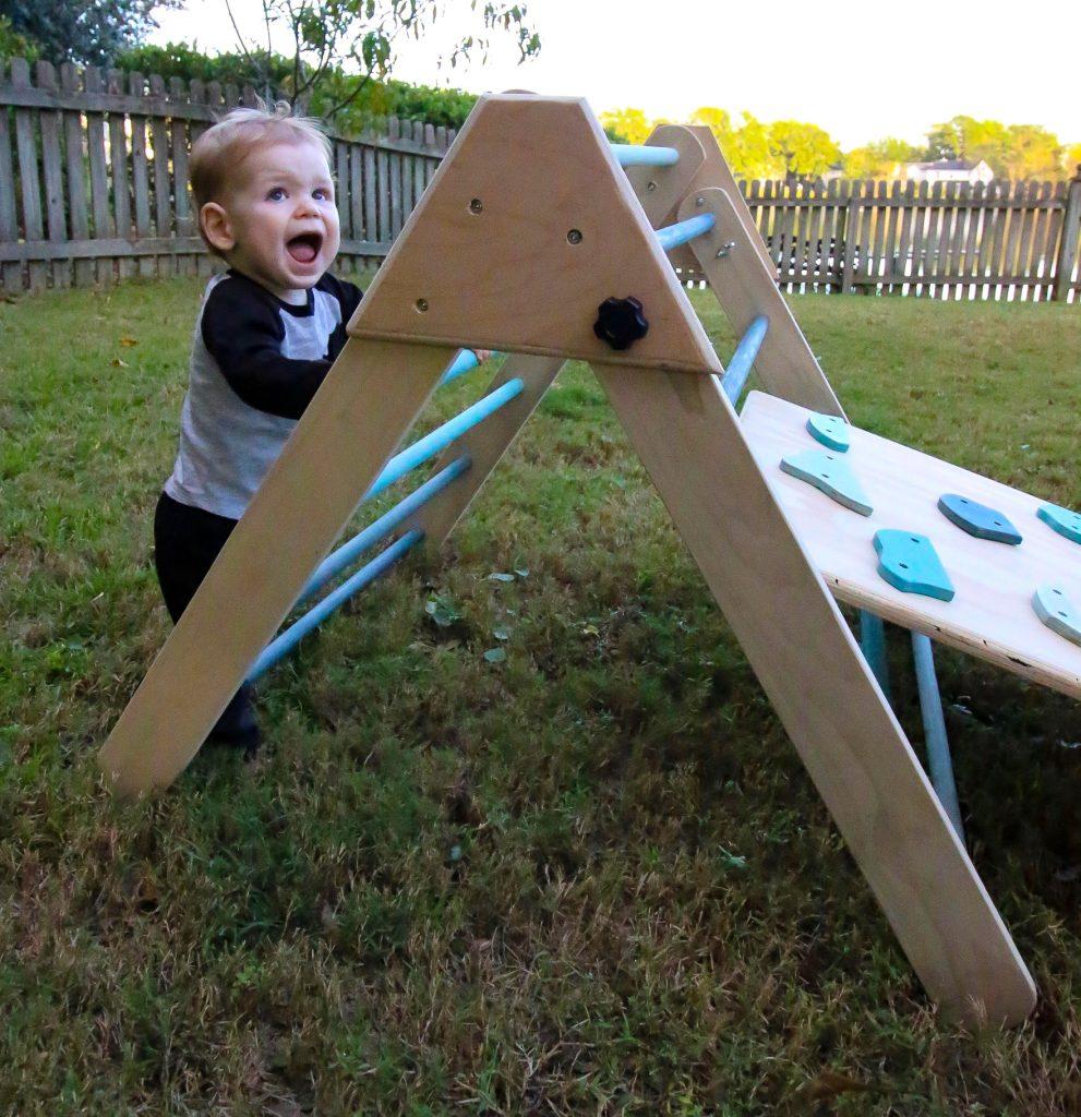 toddler climbing pikler triangle