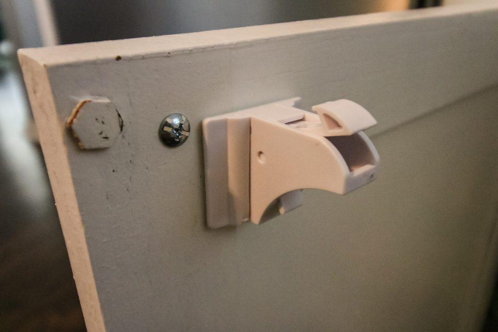 eco baby cabinet locks installed on cabinet door