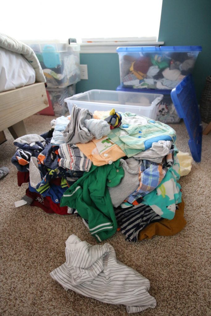 pile of unsorted baby clothes