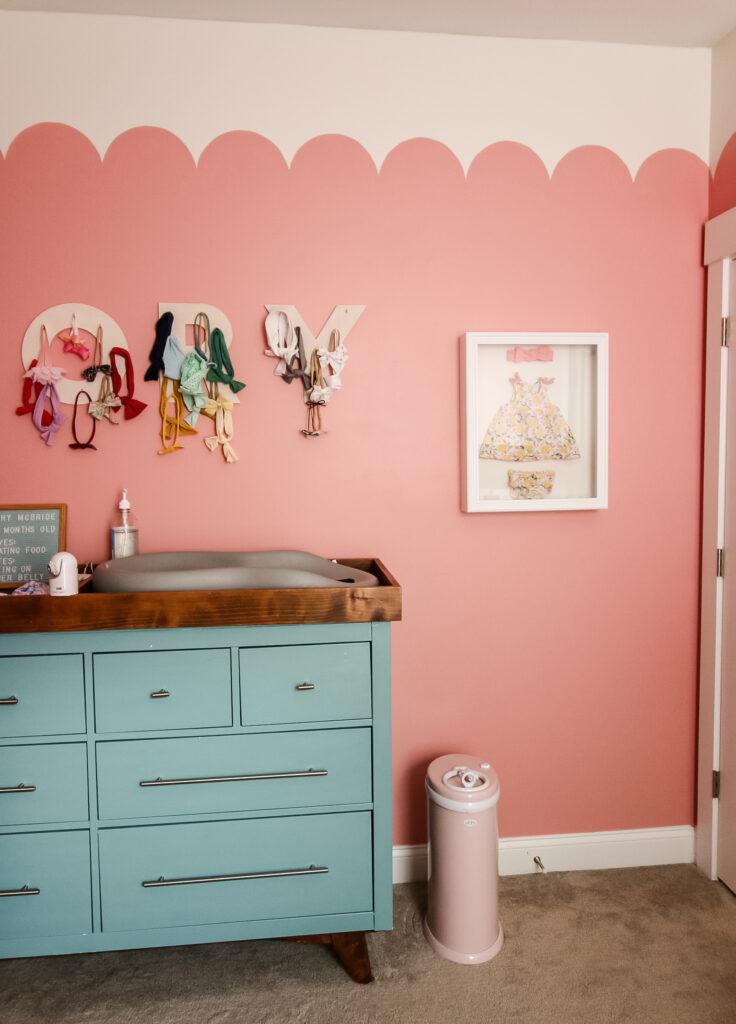 ubbi diaper pail in a pink nursery