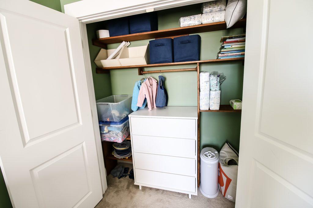 gray ubbi diaper pail in a nursery closet